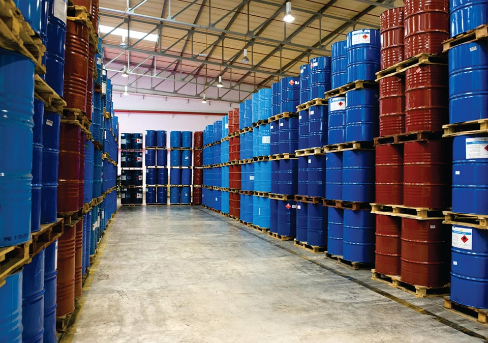 A room with full of red and blue cans of polyurethane chemicals